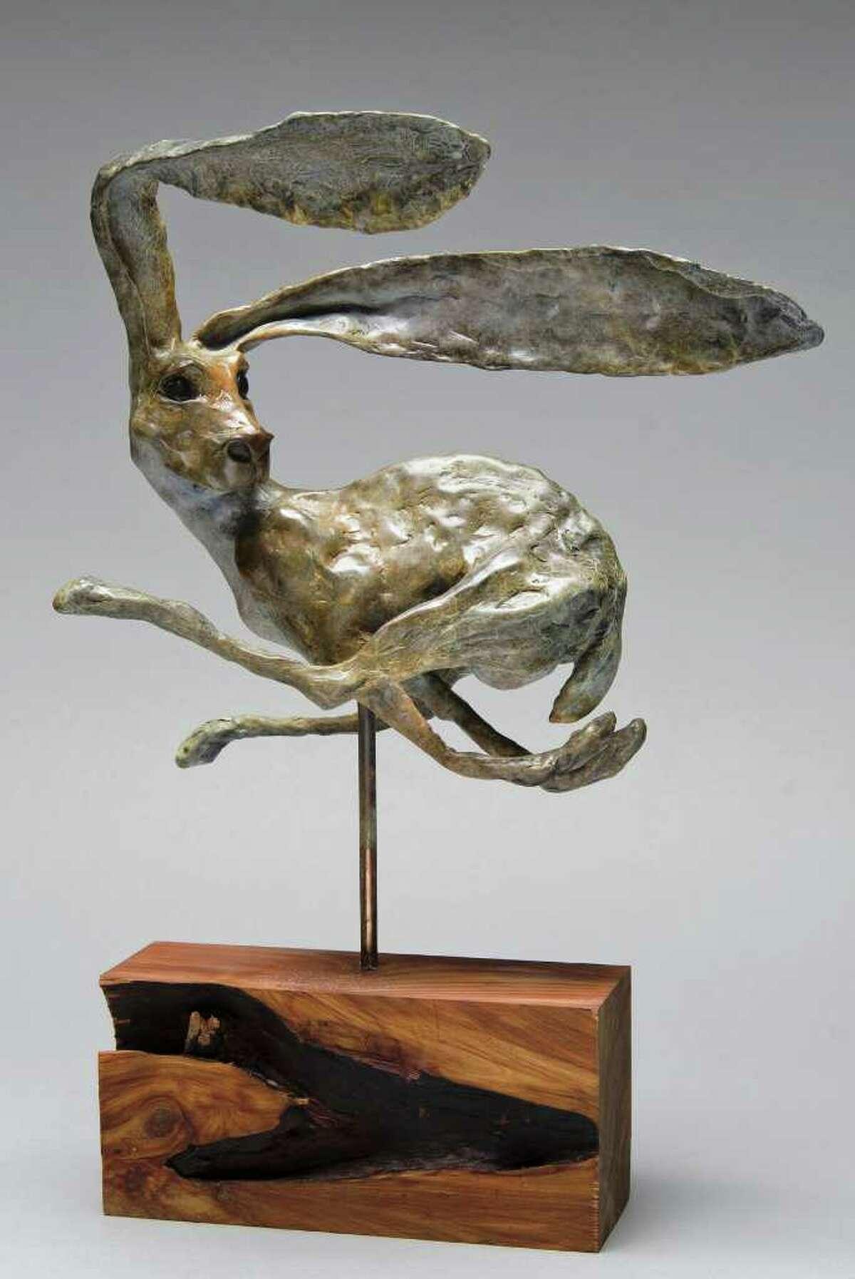 PARCHMAN STREMMEL GALLERY IN MOTION: ¡No Mira Atras! (Don't Look Back) features a jackrabbit in flight.