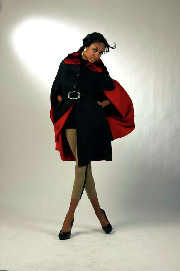 Reversible cashmere belted cape with a chinchilla collar ($5,500) from the Fur Salon at Saks Fifth Avenue. Photo: HELEN L. MONTOYA, STAFF / SAN ANTONIO EXPRESS-NEWS