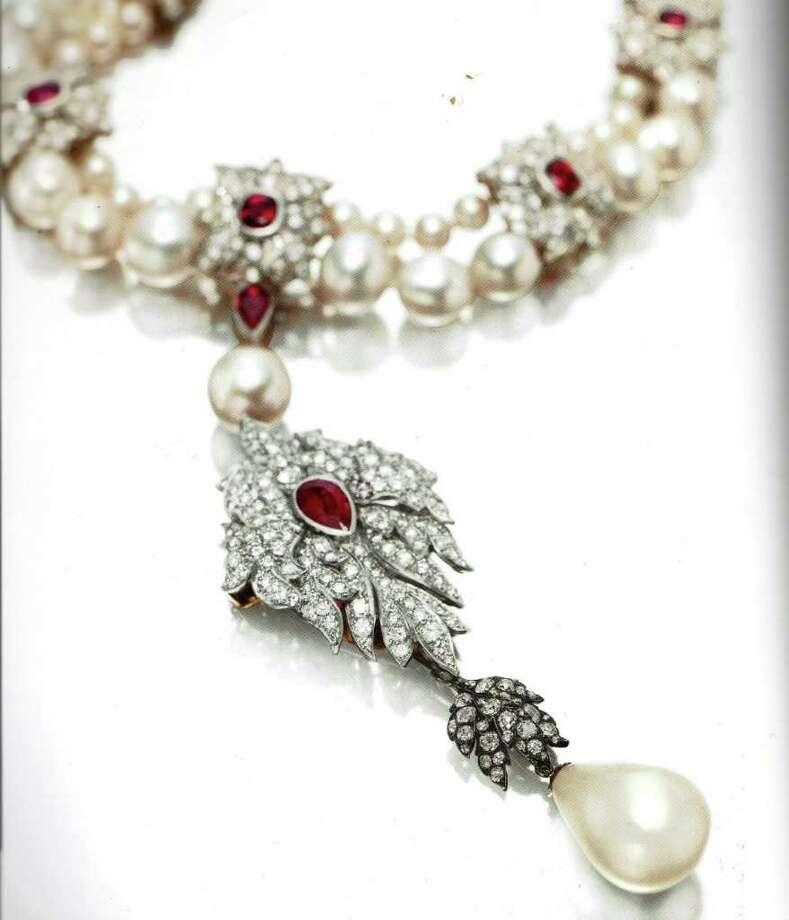 "Elizabeth Taylor's La Peregrina, a natural pearl, diamond, ruby and cultured pearl necklace, by Cartier, sold for $11,842,500 at Tuesday's auction of the late star's ""legendary"" jewels at Christie's . The price set a world auction record for a pearl jewel. Taylor called it ""the most perfect pearl in the world."" Photo: Contributed Photo"