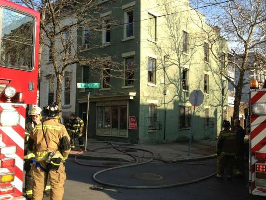 Fire damaged the second floor apartment at 161 Eagle St., on Wednesday, Dec. 14, 2011. No one was hurt. (JORDAN CARLEO-EVANGELIST / TIMES UNION)