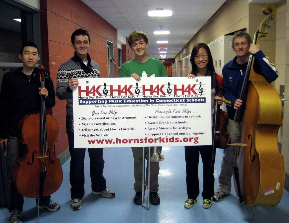 Sean Lee, Steven Ciasullo, Jeffrey Sload, Kristina Lew and Chris Janson pose for a photo with their instruments. Photo: Contributed Photo