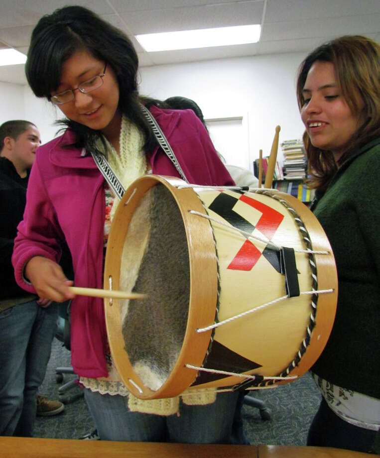 Students in INTAKE's Native Instrument Academy at the Yerwood Center in Stamford get a feel for native Andean instruments at a session recently. Photo: Contributed Photo
