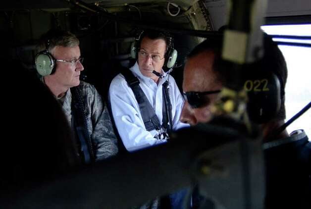 Connecticut Gov. Dan Malloy, center, examines damage from Tropical Storm Irene in a helicopter with Adjutant General Thaddeus Martin, left, near Simsbury, Conn., Monday, Aug. 29, 2011. Photo: AP Photo/Jessica Hill / Connecticut Post Contributed