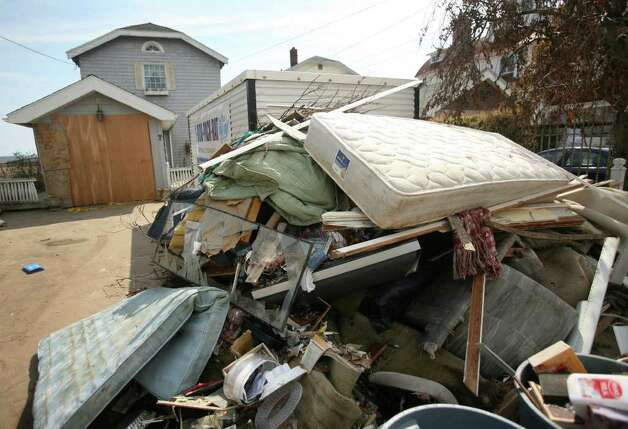 Household items damaged in Hurricane Irene are piled by the street on Point Beach Drive in Milford on Thursday, September 1, 2011. Photo: Brian A. Pounds / Connecticut Post