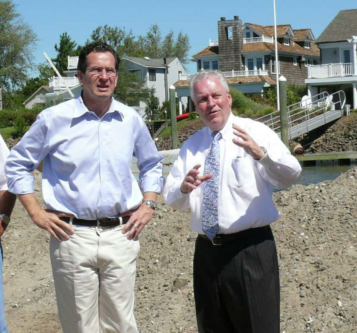 Gov. Dannel Malloy, left, gets a tour from interim First Selectman Michael Tetreau of some of the beach areas damaged by Hurricane Irene.