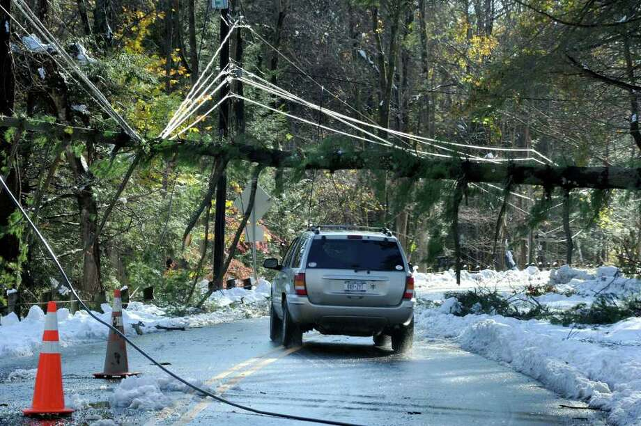 Tree branches rest on wires on Route 37 in Sherman Sunday, the result of Saturday's snowfall.  Photo taken Sunday, Oct. 30, 2011. Photo: Carol Kaliff