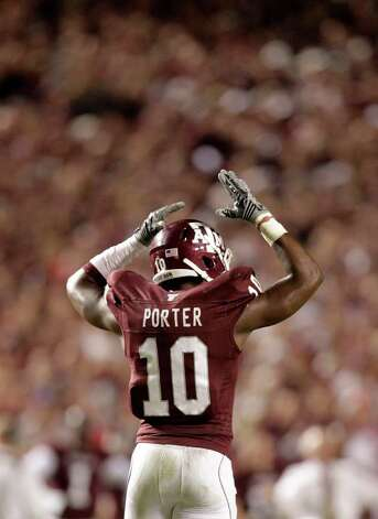 Texas A&M's Sean Porter tries to fire up the crowd during the second quarter of the Texas A&M-Nebraska college football game, Nov. 20, 2010, at Kyle Stadium in College Station. Photo: Karen Warren, Chronicle / Houston Chronicle