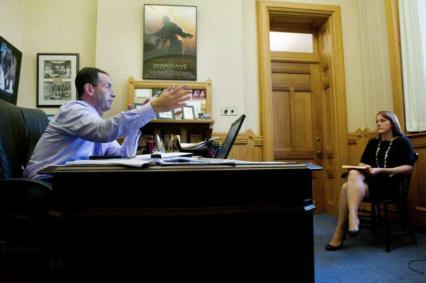 Gov. Dan Malloy's senior advisor Roy Occhiogrosso and Director of Communications, Colleen Flanagan in his office at the state Capitol in Hartford, Conn., October 25, 2011.