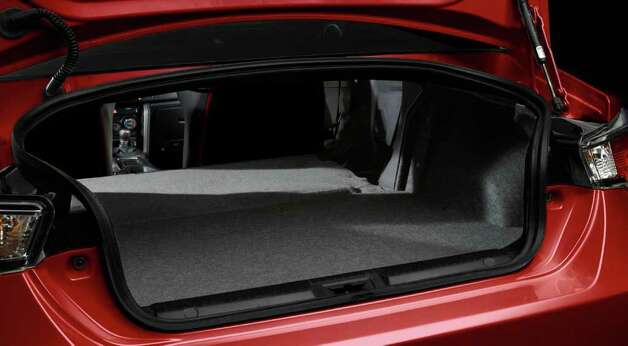 The trunk of the 2013 Scion FR-S can be expanded by folding down the rear seatback. COURTESY OF TOYOTA MOTOR SALES U.S.A. Photo: Toyota Motor Sales U.S.A., COURTESY OF TOYOTA MOTOR SALES U.S.A.