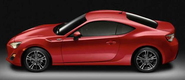 The Scion FR-S will be available with either a six-speed manual or six-speed automatic transmission, and 17-inch alloy wheels are standard. COURTESY OF TOYOTA MOTOR SALES U.S.A. Photo: Toyota Motor Sales U.S.A., COURTESY OF TOYOTA MOTOR SALES U.S.A.
