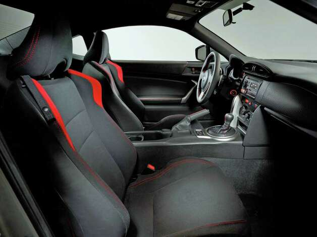 The interior of the 2013 Scion FR-S features two-plus-two seating, with bolstered bucket seats up front. COURTESY OF TOYOTA MOTOR SALES U.S.A. Photo: Toyota Motor Sales U.S.A., COURTESY OF TOYOTA MOTOR SALES U.S.A.