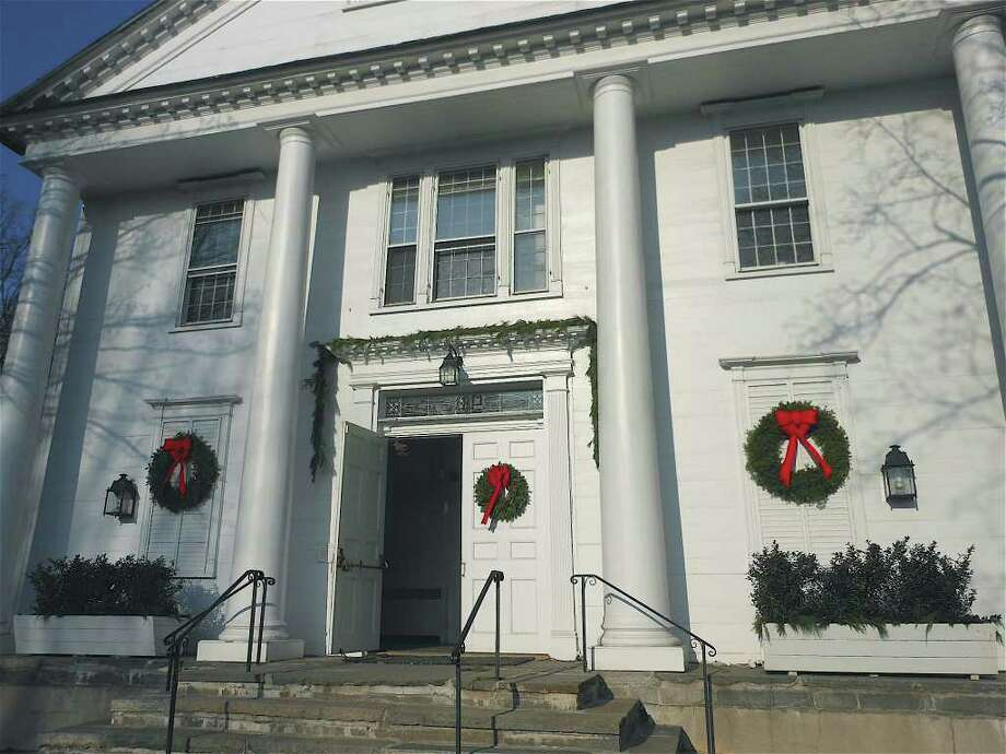 Wreaths bedeck the front of Saugatuck Congregational Church in Westport where, according to church officials, there has been progress in planning restoration of the structure, which was seriously damaged in a Nov. 20 fire. Photo: Mike Lauterborn / Westport News contributed