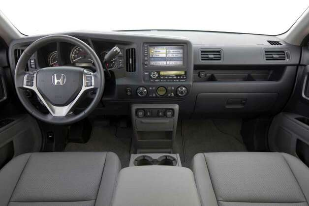 The Honda Ridgeline has essentially the same cockpit as the Pilot crossover. Both leather seats and a navigation system are available. COURTESY OF AMERICAN HONDA MOTOR CO. Photo: American Honda Motor Co., COURTESY OF AMERICAN HONDA MOTOR CO. / Honda