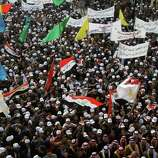 People chant anti-US slogans during a demonstration in Fallujah, 40 miles west of Baghdad, Iraq, on Wednesday. , Dec. 14, 2011. Thousands of people gathered in