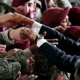 President Barack Obama greets members of the military at the 440th Structural Maintenance Hangar at Fort Bragg, N.C., on Wednesday. He saluted the troops in an adress.