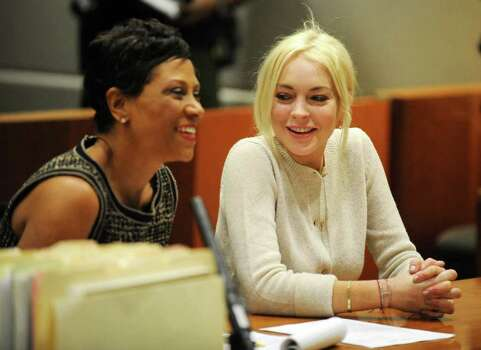 Lindsay Lohan, right, alongside her attorney Shawn Chapman Holley are seen during a progress report session at the Los Angeles Superior Court on Wednesday. Photo: AP