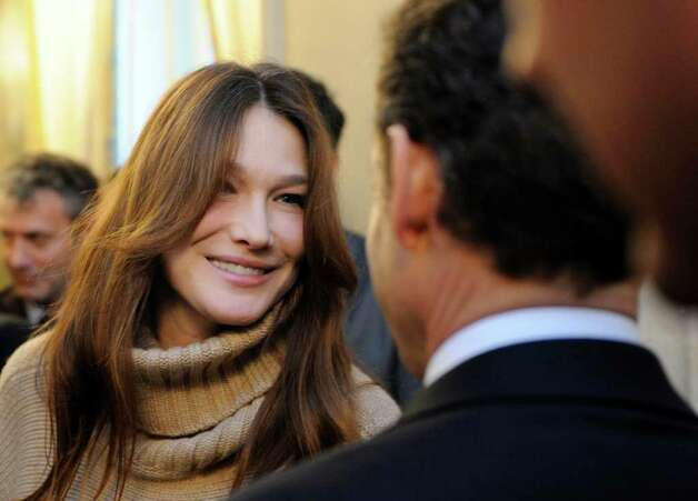 France's first lady Carla Bruni-Sarkozy looks at her husband, President Nicolas Sarkozy, during the traditional Christmas party at the Elysee Palace in Paris, Wednesday. Photo: Eric Feferberg, AP / AFP Pool