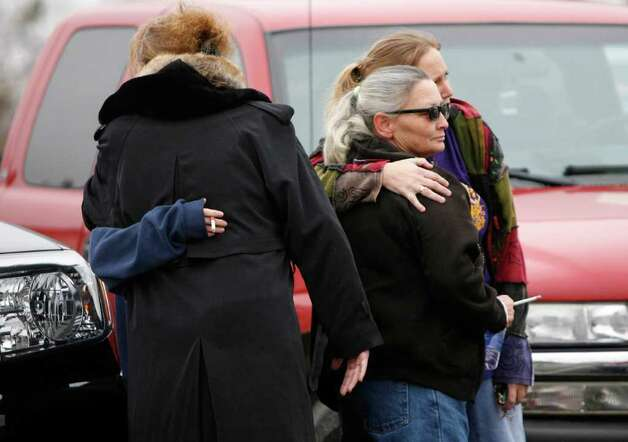 Relatives of  Taylor Paschal-Placker share embraces after a hearing for Kevin Sweat at the Okfuskee County Courthouse in Okemah, Okla. on Tuesday.  Sweat is charged with first-degree murder in the June 2008 deaths of 13-year-old Taylor Placker and 11-year-old Skyla Whitaker near Weleetka. He faces the same charge in the death earlier this year of his girlfriend, Ashley Taylor. Photo: AP