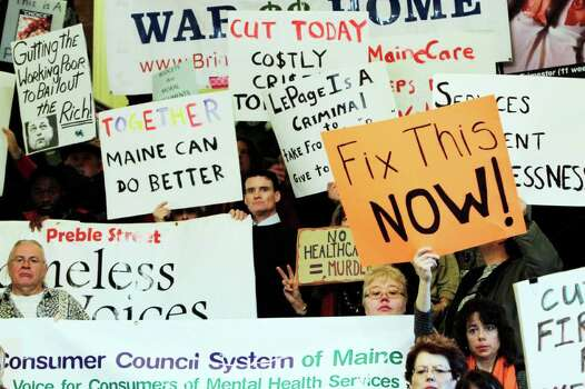 Dozens join in a rally voicing their concerns about proposed budget cuts in the Medicaid system, during a rally at the State House in Augusta, Maine, on Wednesday. Photo: AP