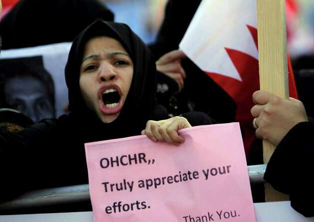Tens of thousands of Bahraini anti-government protesters wave Bahraini flags and shout slogans Wednesday, outside the United Nations offices in Manama, Bahrain. Photo: Hasan Jamali, AP / AP