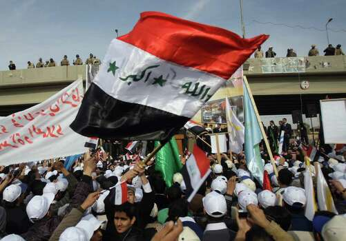 "People chant anti-US slogans during a demonstration in Fallujah, 40 miles  west of Baghdad, Iraq, Wednesday. Thousands of people on gathered in Fallujah to celebrate the US withdrawal, hoisting Iraqi flags and holding dozens of banners that says ""Fallujah, the symbol of resistance"" and ""Fallujah the symbol of honorable resistance"" and ""Fallujah that represent the stability"" and ""Fallujah represents Steadfastness ."" (AP Photo/Khalid Mohammed) Photo: Khalid Mohammed, ASSOCIATED PRESS / AP2011"