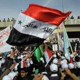 "People chant anti-US slogans during a demonstration in Fallujah, 40 miles  west of Baghdad, Iraq, Wednesday. Thousands of people on gathered in Fallujah to celebrate the US withdrawal, hoisting Iraqi flags and holding dozens of banners that says ""Fallujah, the symbol of resistance"" and ""Fallujah the symbol of honorable resistance"" and ""Fallujah that represent the stability"" and ""Fallujah represents Steadfastness ."" (AP Photo/Khalid Mohammed)"