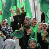 Palestinian women gather during a rally to mark 24 years since Hamas' founding, in Gaza city, on Wednesday. , Dec. 14, 2011.  Tens of thousands of Gazans turne  (AP Photo/Hatem Moussa)