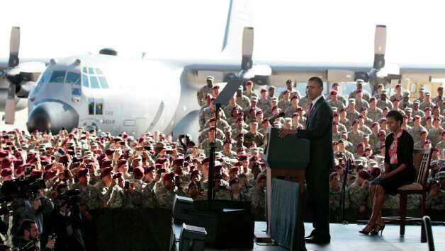 President Barack Obama, accompanied by first lady Michelle Obama, speaks to troops at Fort Bragg, N.C., on Wednesday. Photo: AP