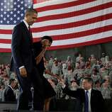 President Barack Obama and first lady Michelle Obama leave the stage to greet members of the military at Fort Bragg, N.C., on Wednesday.
