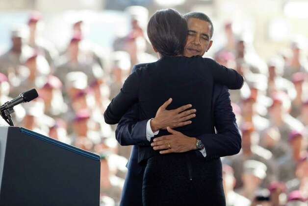 President Barack Obama hugs first lady Michelle Obama at Fort Bragg, N.C., on Wednesday. Photo: AP