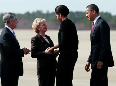 President Barack Obama and first lady Michelle Obama are greeted by North Carolina Governor Bev Perdue and her husband, Bob Eave,s upon their arrival at Fort Bragg, N.C., on Wednesday. Photo: AP