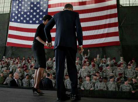 President Barack Obama and first lady Michelle Obama leave the stage to greet members of the audience in the 440th Structural Maintenance Hangar at Fort Bragg, N.C., on Wednesday. Photo: AP