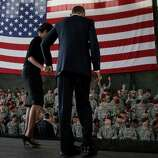 President Barack Obama and first lady Michelle Obama leave the stage to greet members of the audience in the 440th Structural Maintenance Hangar at Fort Bragg, N.C., on Wednesday.
