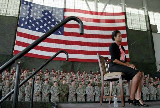 First lady Michelle Obama listens as President Barack Obama speaks to troops at Fort Bragg, N.C., on Wednesday. Photo: AP