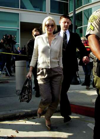 Lindsay Lohan is escorted out of  the Los Angeles Superior Court on Wednesday. Photo: AP