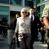Lindsay Lohan is escorted out of  the Los Angeles Superior Court on Wednesday.