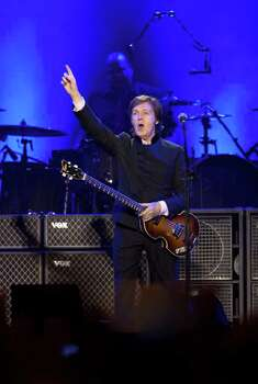 "Paul McCartney performs on stage during his ""Good Evening Europe"" European Tour, his first since 2003, at Olympic Hall in Moscow,  Russia, on Wednesday. (AP Photo/Alexander Zemlianichenko) Photo: Alexander Zemlianichenko, ASSOCIATED PRESS / AP2011"