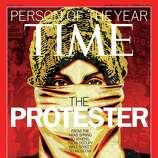 "This image released by Time Magazine shows the Person of the Year issue featuring ""The Protester."" The magazine on Wednesday cited dissent across the Middle East that has spread to Europe and the United States, and says these protesters are reshaping global politics."