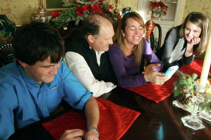 METRO: Rocky, Lori, Fred and Natalie speak with Naika Etienne on the phone on Tuesday Dec. 6, 2011.