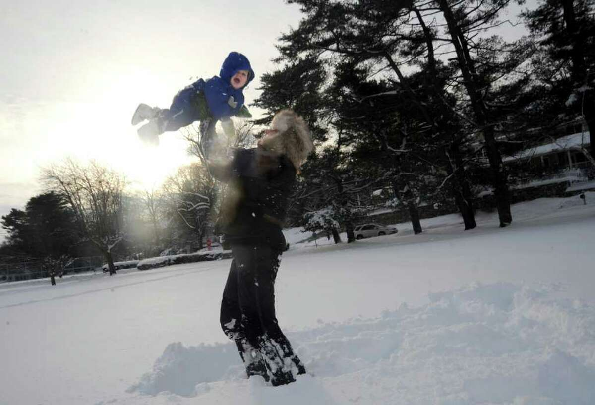 Susannah Sullivan, of Old Greenwich, plays in the snow with her daughter India, 11 months, in Binney Park, in Old Greenwich, on Wednesday, Jan. 12, 2011.