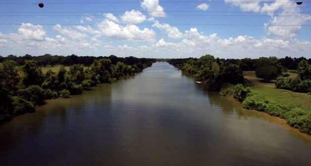 The Colorado River flows near the South Texas Project electric generating station, and critics of the plant's expansion are worried about flows in the river when water is taken from the river for the plant's use. JOHN DAVENPORT/jdavenport@express-news.net Photo: JOHN DAVENPORT, SAN ANTONIO EXPRESS-NEWS / jdavenport@express-news.net