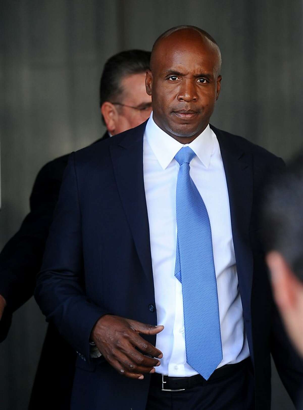 Former Giants slugger Barry Bonds leaves federal court on Thursday, June 23, 2011, in San Francisco. A judge gave the prosecution more time to decide whether to retry Bonds on three perjury counts.
