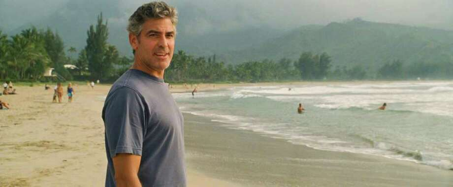 "Actor George Clooney as ""Matt King"" on the set of THE DESCENDANTS. Photo Credit: Merie Wallace / 2011 Twentieth Century Fox Fil"