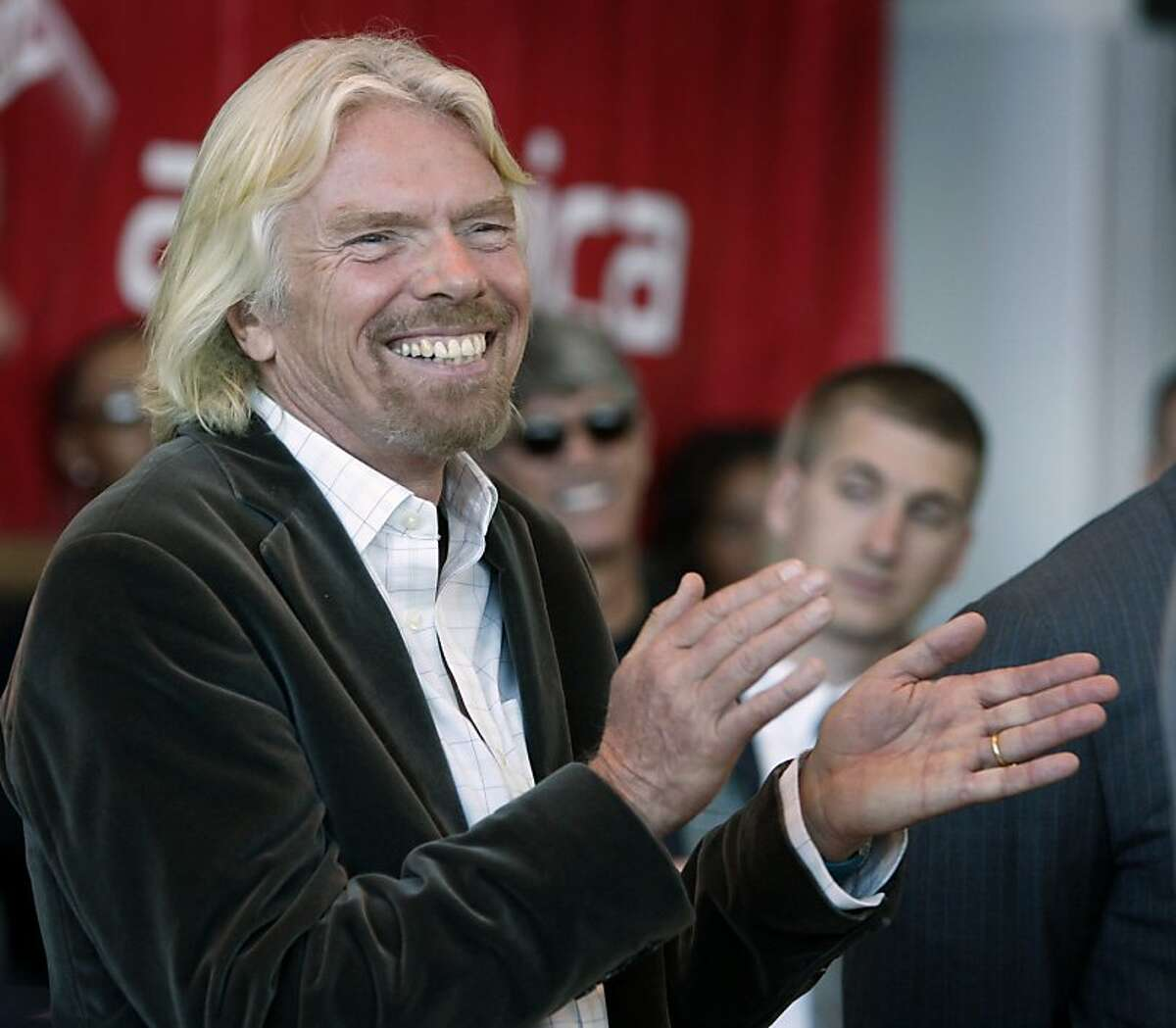 Virgin America airlines founder Sir Richard Branson beams at a reception before the airlines' inaugural flight to Toronto at San Francisco International Airport in San Francisco, Calif., on Tuesday, June 29, 2010. Ran on: 06-30-2010 In addition to Virgin America, Sir Richard Branson is also working on Virgin Galactic, a space ship travel project, and Virgin Oceanic, submarine travel.