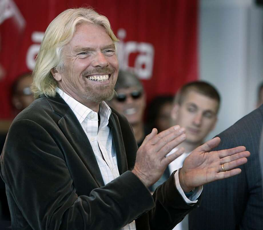 Virgin America airlines founder Sir Richard Branson beams at a reception before the airlines' inaugural flight to Toronto at San Francisco International Airport in San Francisco, Calif., on Tuesday, June 29, 2010.  Ran on: 06-30-2010 In addition to Virgin America, Sir Richard Branson is also working on Virgin Galactic, a space ship travel project, and Virgin Oceanic, submarine travel. Photo: Paul Chinn, The Chronicle