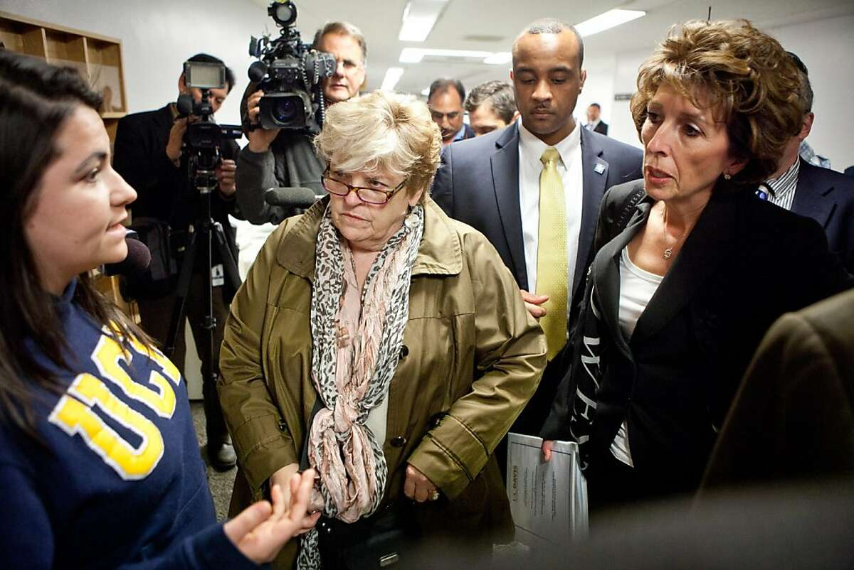 University of California, Davis student Jerika Heinze, left confronts chancellor Linda Katehi, right, outside a Joint Informational Hearing on the UC Davis pepper spray incident at the State Capitol in Sacramento, CA, December 14, 2011.