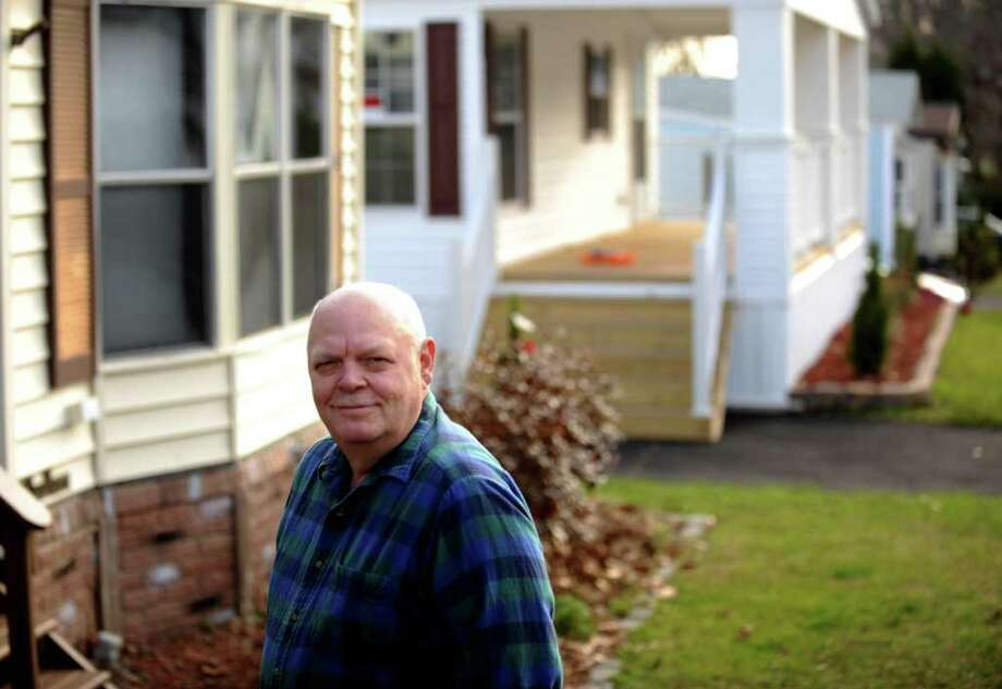 Chester Galemba, president of the Woodland Park Homeowners Association, stands outside his mobile home in Shelton, Conn. Photo: Autumn Driscoll / Connecticut Post