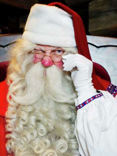 Santa Claus winks at visitors in his office in the Santa Park near Rovaniemi, Finnish Lapland, on De