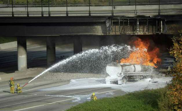 Montebello firefighters battle a blaze from a tanker truck on the eastbound 60-freeway underneath the Paramount Boulevard bridge in Montebello, Calif. Wednesday. Photo: AP