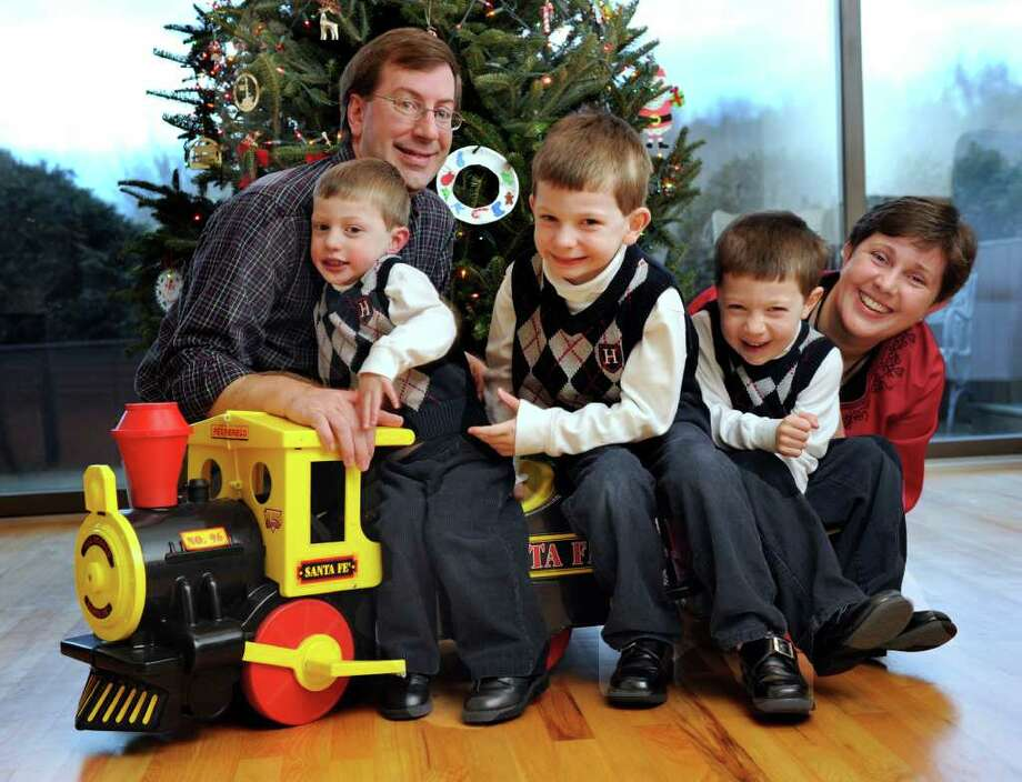 Mike and Marie Hatcher of Sherman with their three sons, from left, Matthew, 3, Michael, 6, and Ryan, 5. Photo taken Wednesday, Dec. 14, 2011. Photo: Carol Kaliff